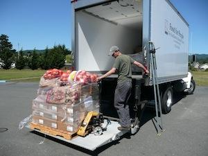 A load of commodities being loaded into a truck to be distributed the our Pantry Network